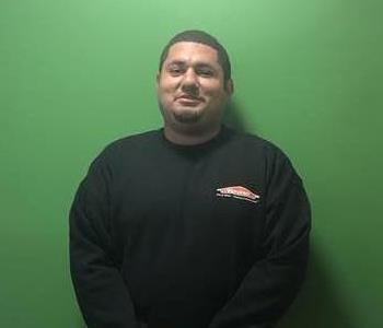 Gentleman wearing an long sleeve black SERVPRO shirt