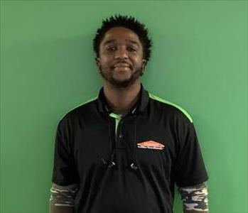 Male, black SERVPRO shirt, smiling