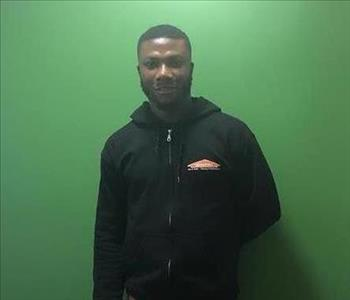 Gentleman wearing an black SERVPRO sweater